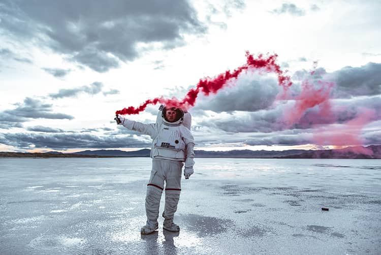 astronaut with color bomb