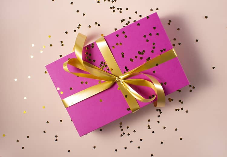 pink gift box with yellow ribbon