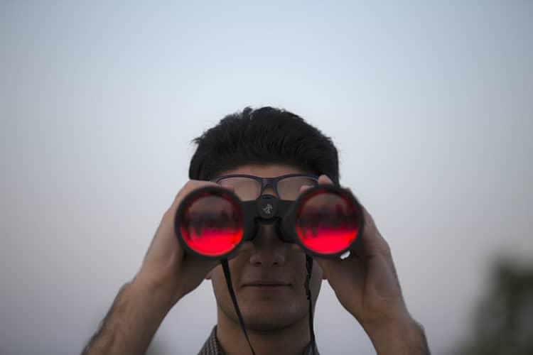 red binoculars man