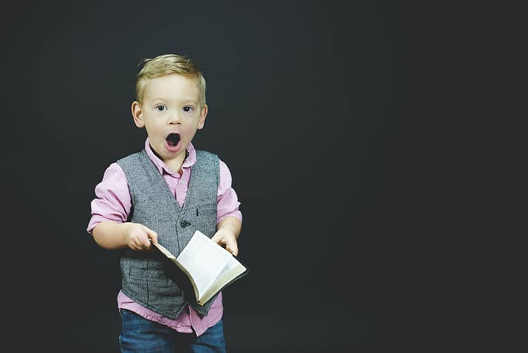 young boy learning surprised