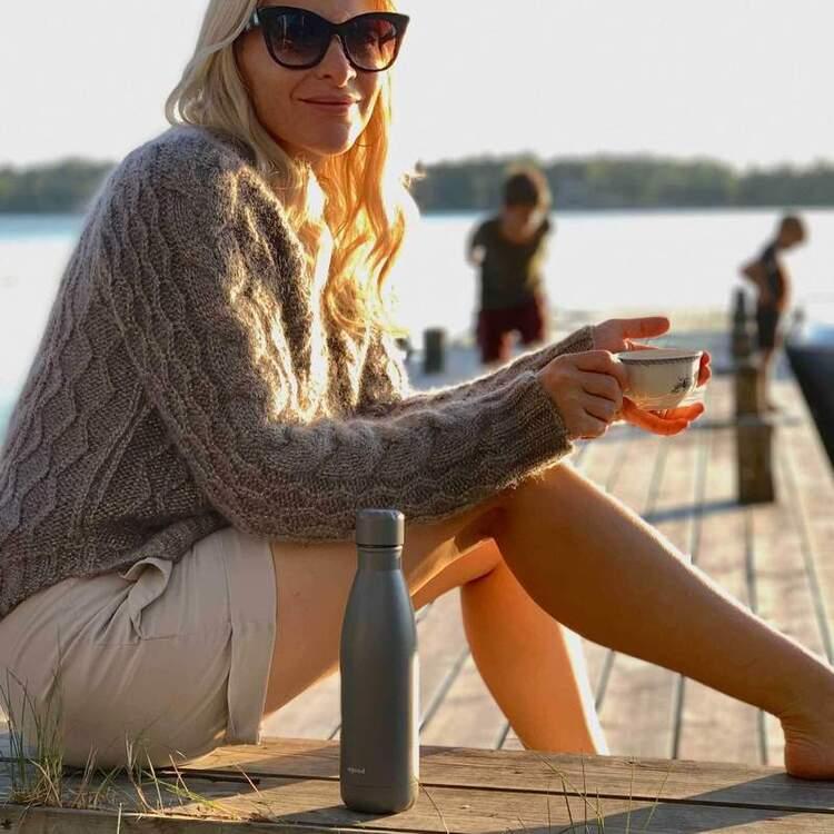 Woman on a dock near a lake