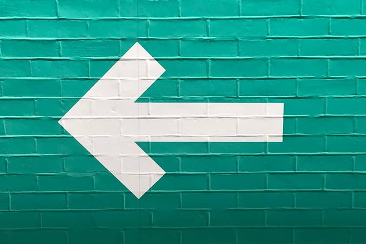 white arrow on green wall