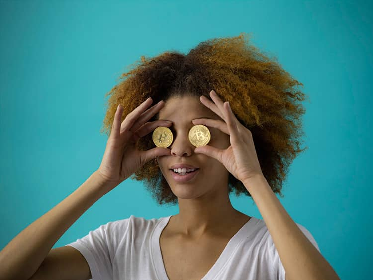 woman looks at coins