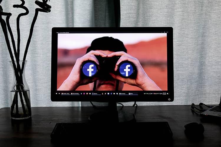 man looking binoculars facebook
