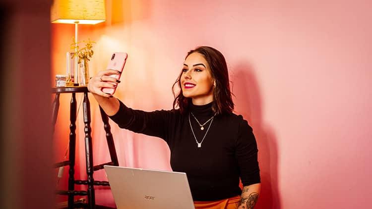 woman black long sleeve blouse taking selfie